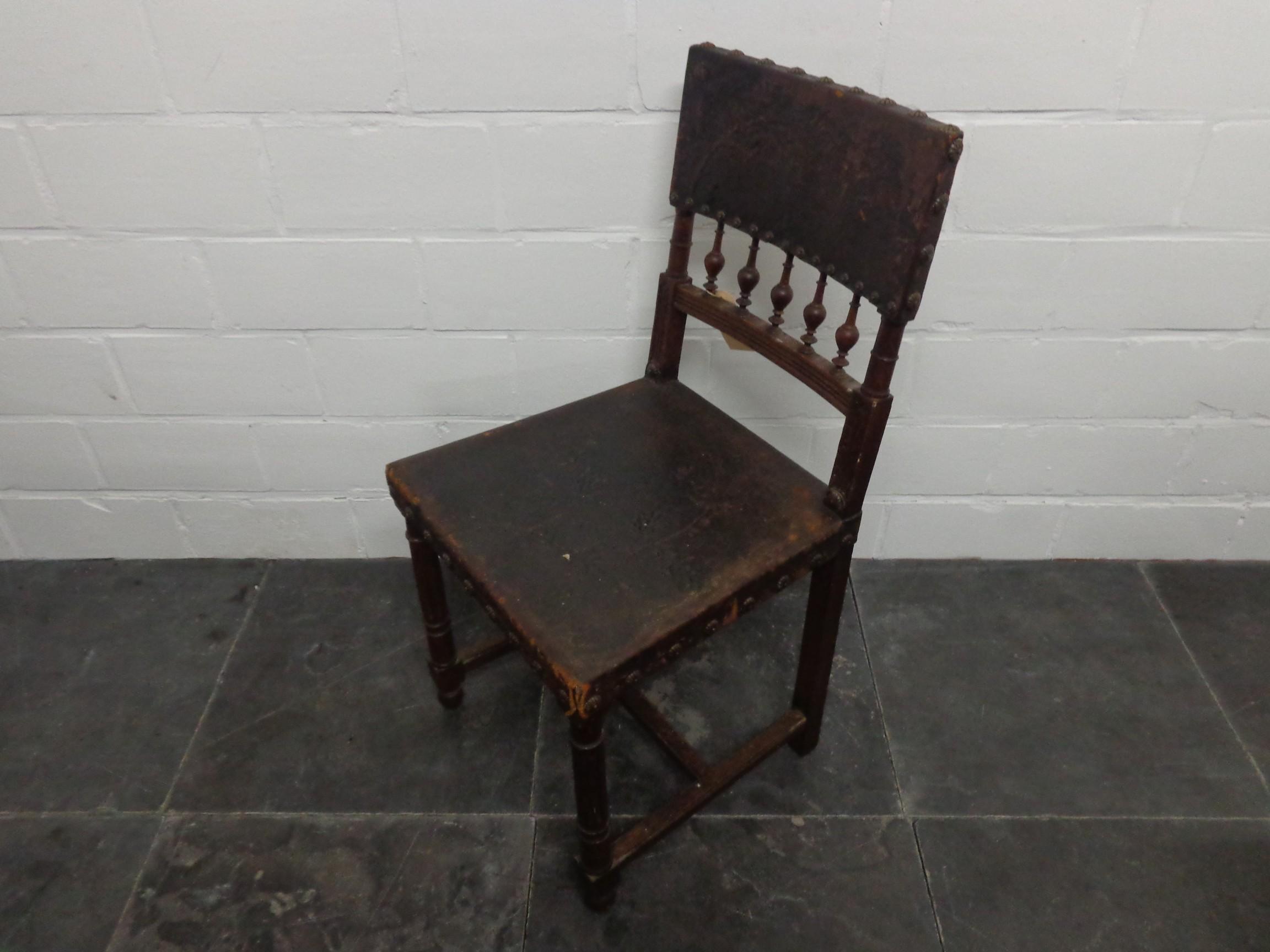 4 versierde lederen stoelen for Lederen stoelen